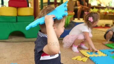 Little children playing with puzzles and toys.