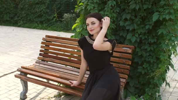 Portrait of young girl on a bench in the Park.