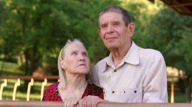 Portrait of elderly grandparents in Park gazebo.