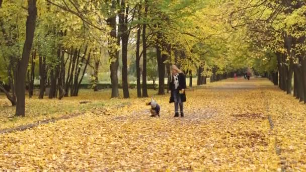 Mother and son walking in autumn Park.