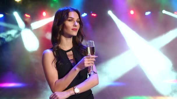Portrait of girl with champagne at a party in dark