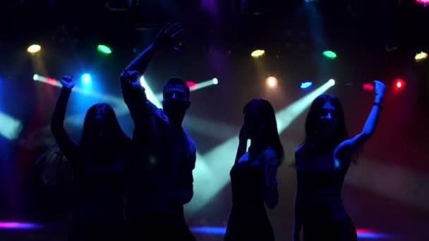 Sziluettjét a fiatalok nightclub tánc.