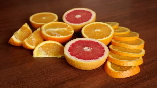 Sliced oranges and grapefruit on wooden background