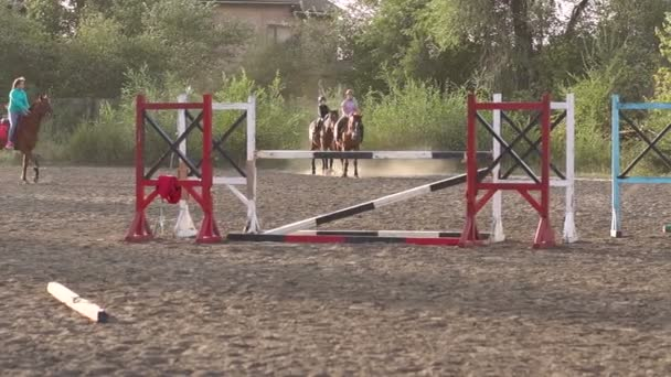 Group of children engaged in equestrian sports.