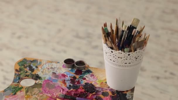 Palette with paints and brush set for drawing.