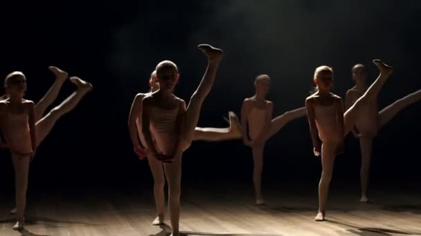 Young children dancing ballet on a stage. Ballet.