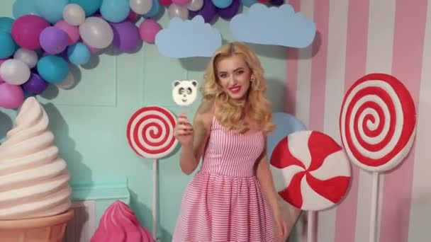 Portrait of funny girl with lollipops in her hands
