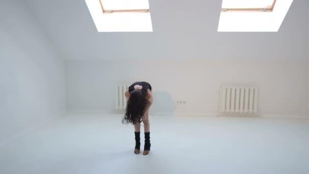 Sexy girl dancing sensual dance bachata in Studio.