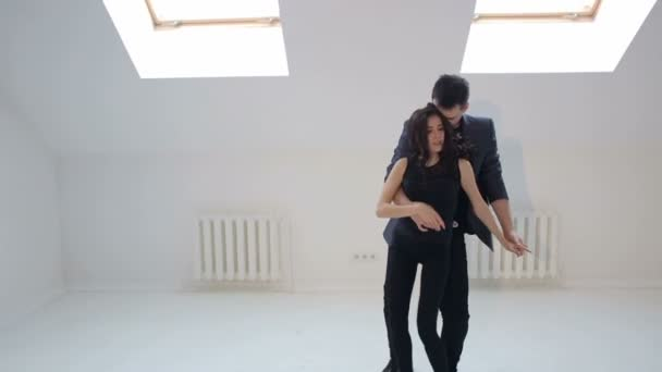 Young couple dancing the salsa at the dance hall.