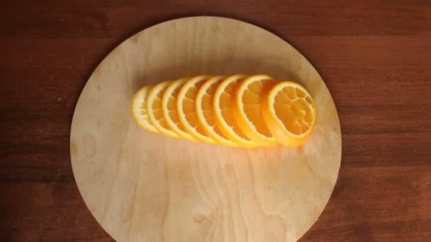 Sliced ripe orange on a wooden Board, close-up.