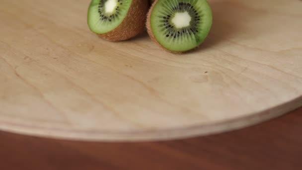 Ripe kiwi on wooden table on a cutting Board, CU