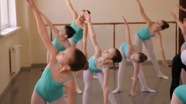 Little girls do stretches before the rehearsal of the ballet at ballet Studio.
