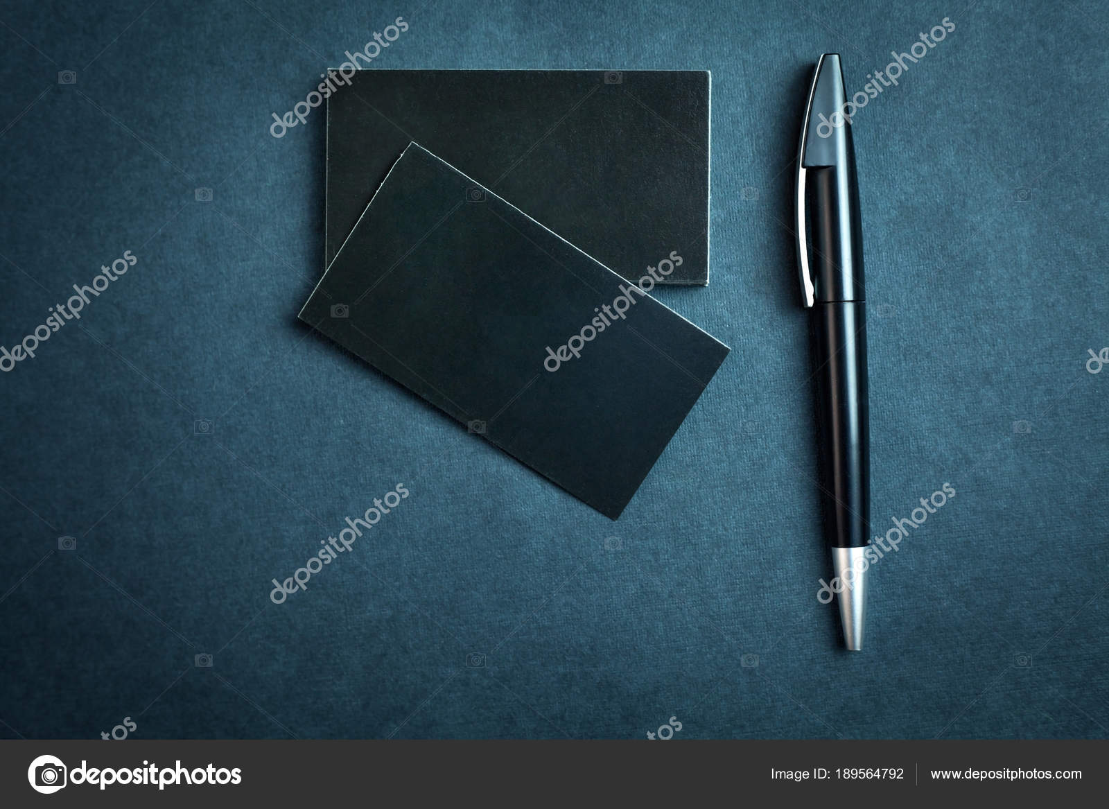 Black Business Cards And Pen On A Blue Background Stock Photo