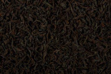 Dry black tea leaves texture background.