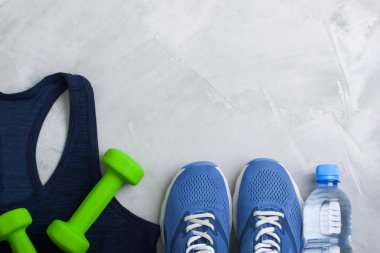 Flatlay sport composition with equipment outfit blue sneakers an