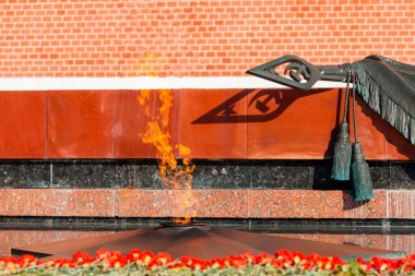 Tomb of Unknown soldier and Eternal flame in Alexander garden near Kremlin wall in Moscow, Russia