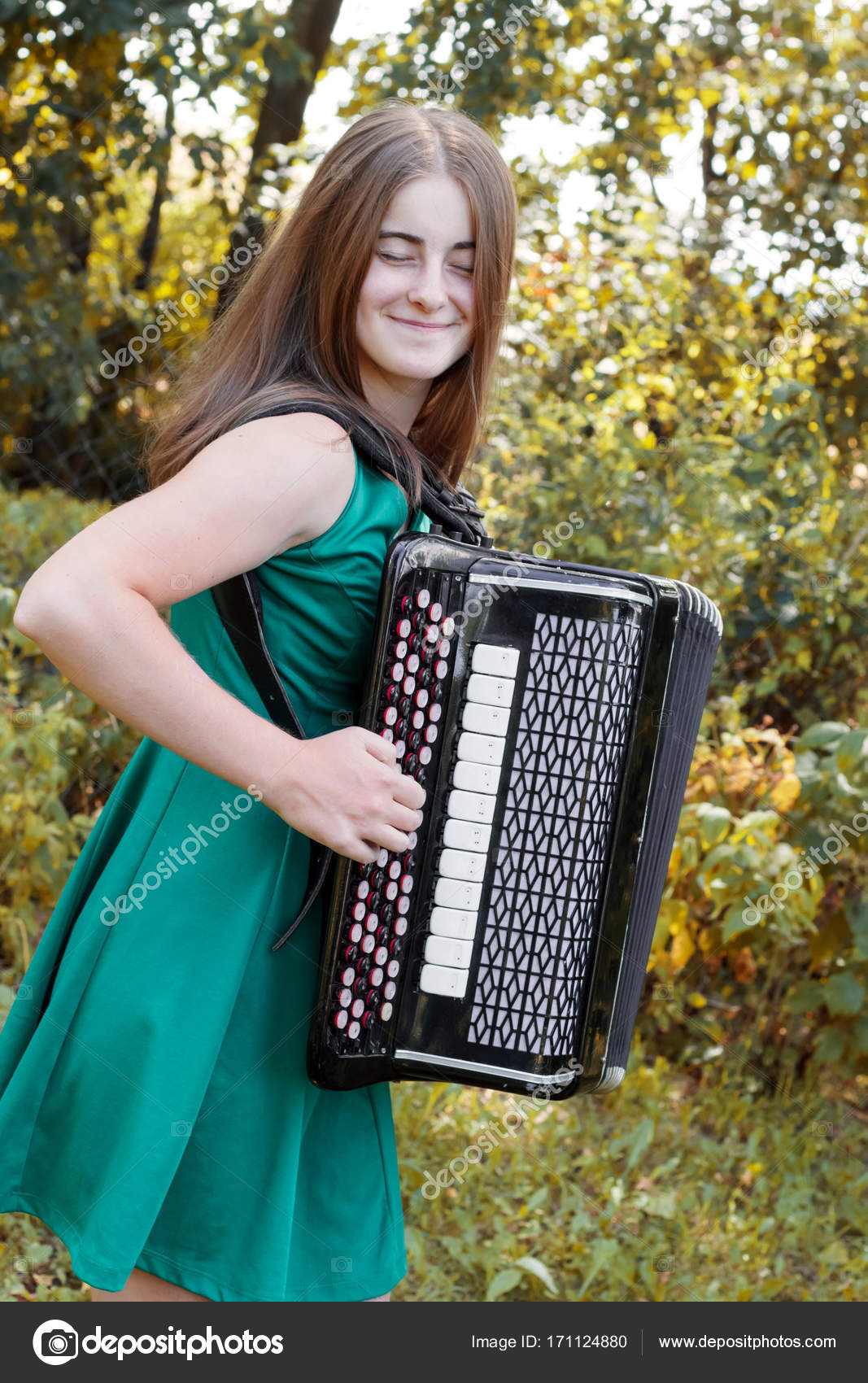 Girl musician plays the the Russian bayan (button accordion) and