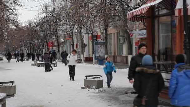 people walking on city street at wintertime