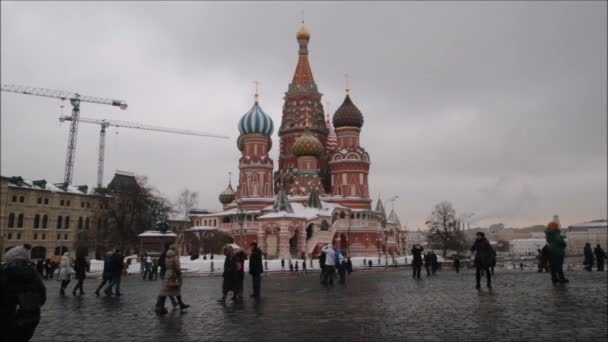 Moscow, Russian Federation - January 28, 2017: Kremlin : People enjoy life in  Red Square in a cloudy winter day with landscape of St. Basil s Cathedral