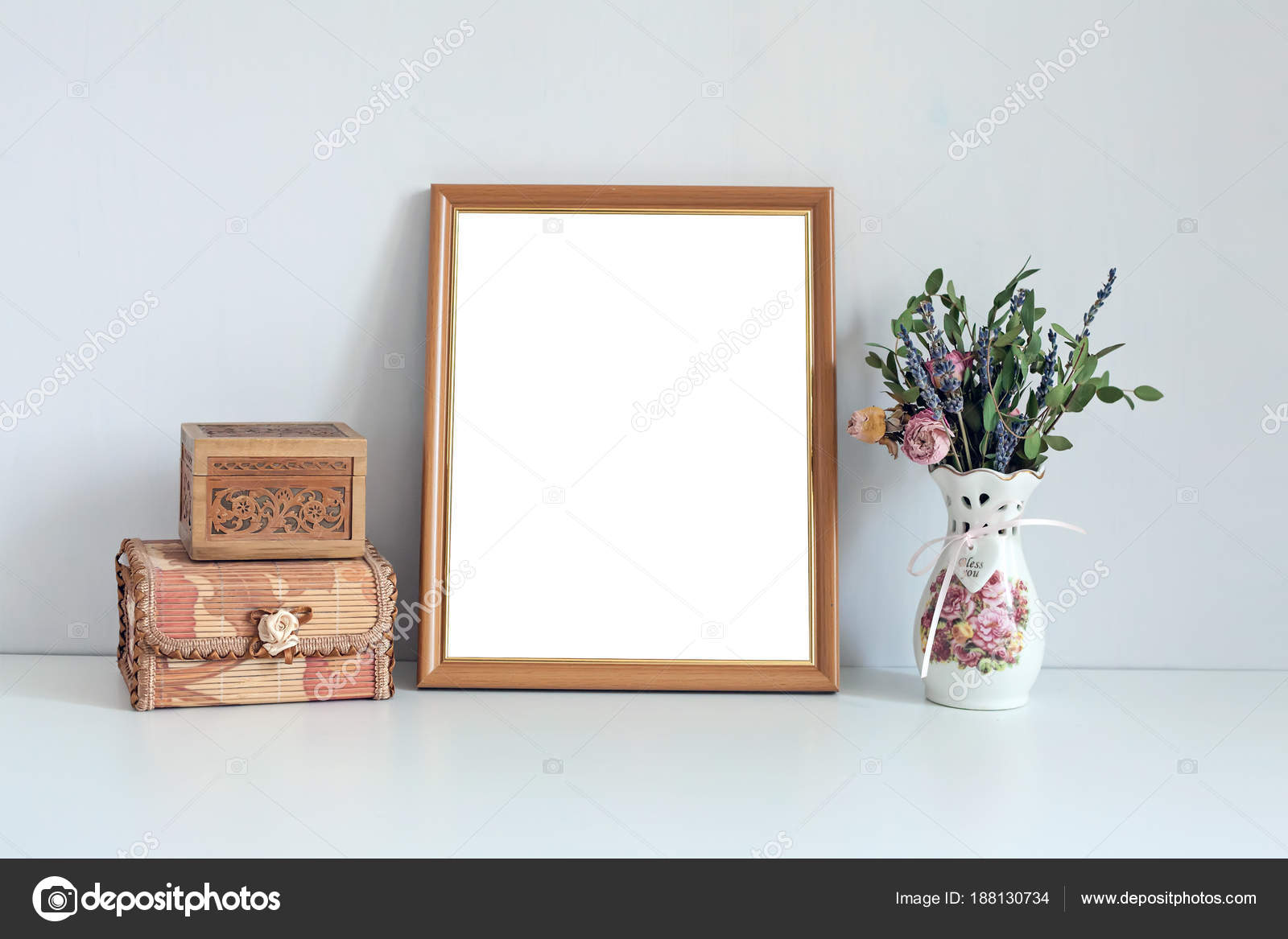 Mockup 8x10 Wooden Frame With Boxes And Flowers Stock Photo