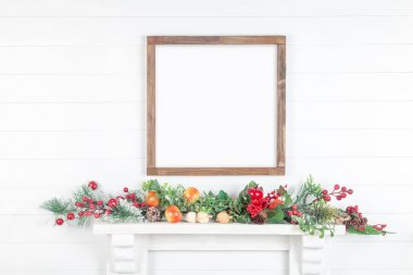 Mock up square rough wooden frame on white wall with bright autu