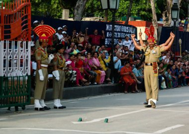 The marching Indian guards in national uniform at the ceremony of lowering the flags on the border between Pakistan and India, Wagah, Lahore, Pakistan
