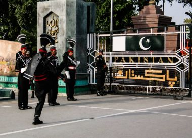 The marching Pakistani guards in national uniform at the ceremony of lowering the flags on the border between Pakistan and India, Wagah, Lahore, Pakistan