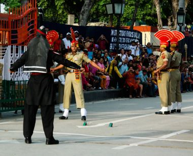 The marching Pakistani and Indian guards in national uniform at the ceremony of lowering the flagsLahore, Pakistan
