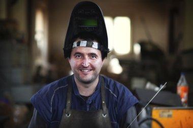 welder using acetylene welding outfit