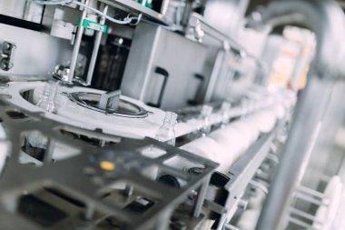 Robotic factory line bottling water into bottles