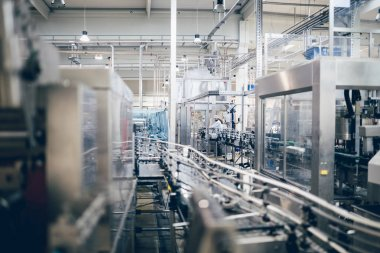 Robotic factory line water bottled into canisters