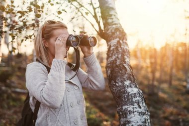 blond woman with binoculars