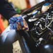 stock-photo-car-service-mechanic-working-automobile