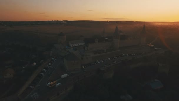 Aerial view of castle at sunset. 4K drone footage