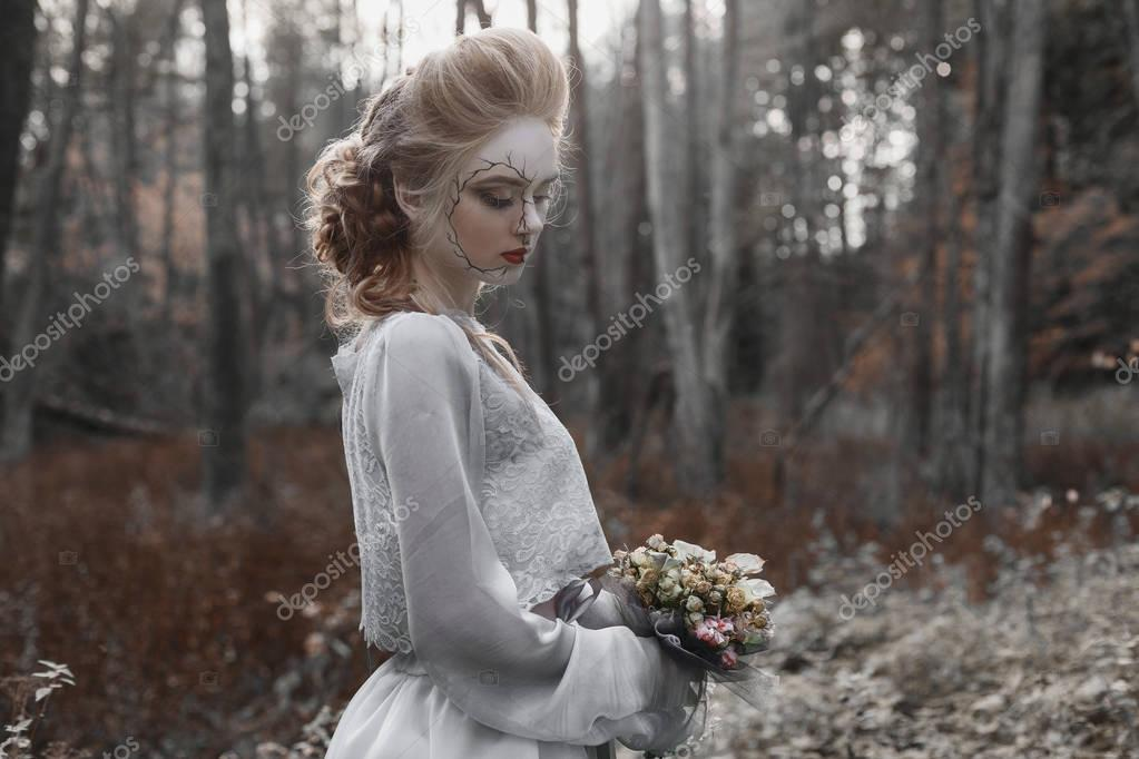 The image of the bride on Halloween night in the forest
