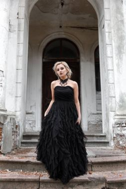 Portrait of a young woman in black dress. Wedding
