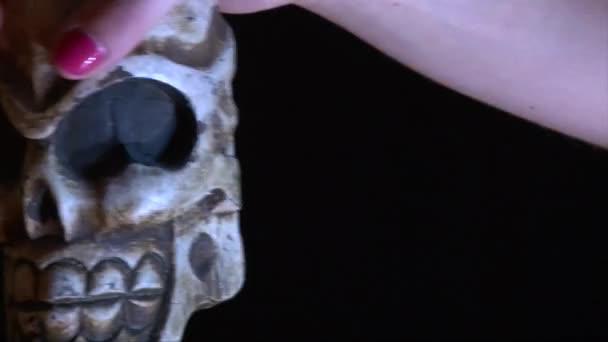 Halloween Decoration Skull Moving In Girl Hands Strobe Lights On Black Stock Video
