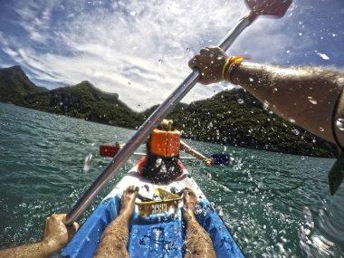Young woman and man - couple kayaking in beautiful Ang Thong National Marine Park Thailand