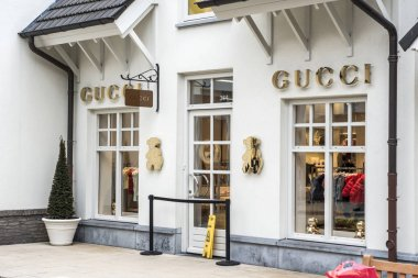 Roermond, Netherlands 07.05.2017 Logo and shop of GUCCI Store Mc Arthur Glen Designer Outlet shopping area