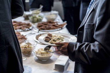 people group catering buffet food indoor luxury restaurant with meat and salad