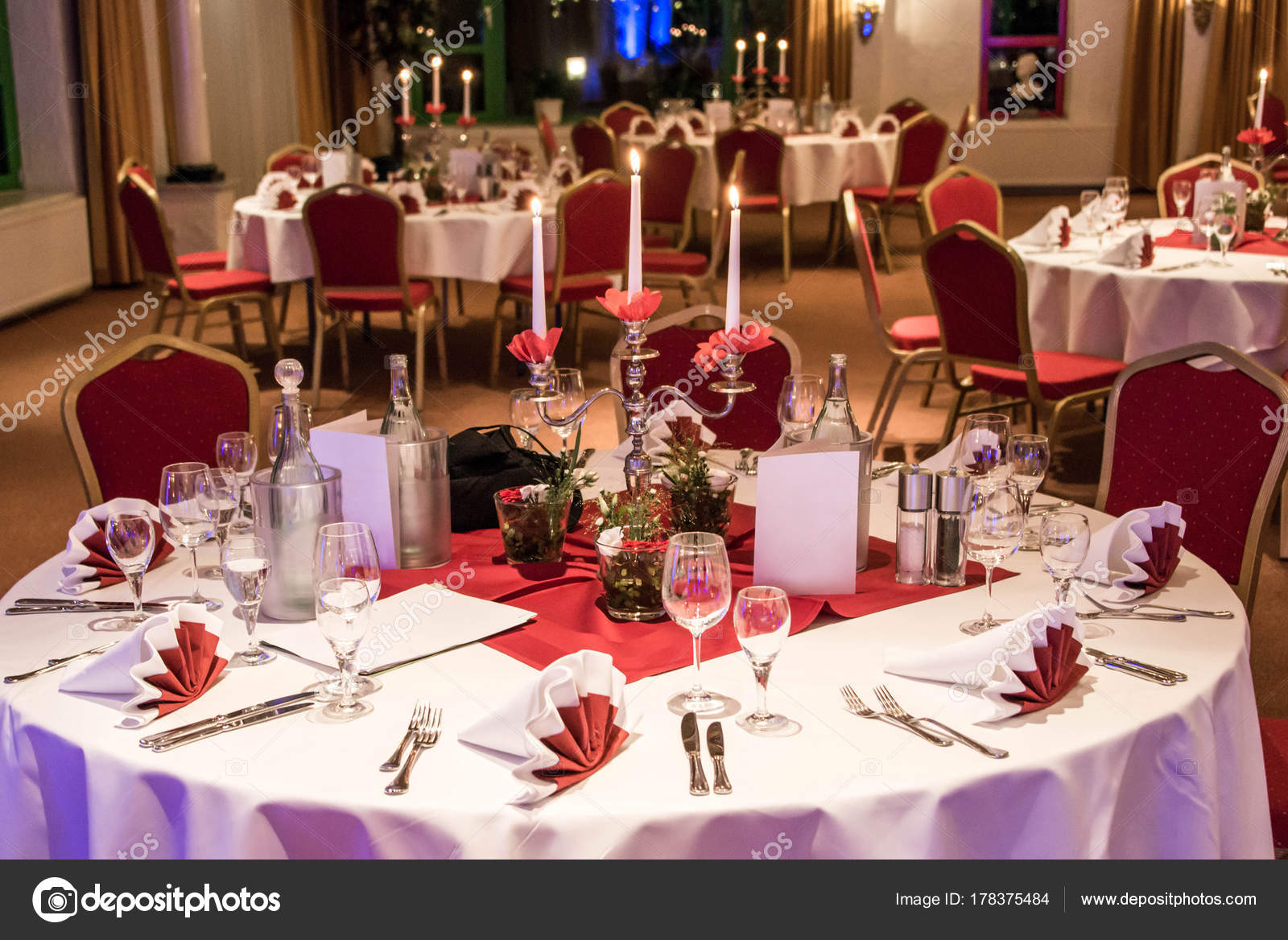 Banquet with red table setting Red tablecloth white dishes silver cutlery and glasses plus some decorations white copy text space card u2014 Photo by donogl & Banquet with red table setting tablecloth white dishes silver ...