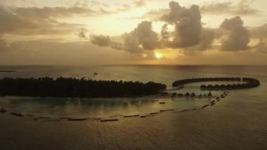 Aerial shooting  during gold sunset over the luxury island
