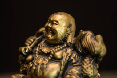 Chinese figurine Hotei, the laughing Buddha is a symbol of prosperity