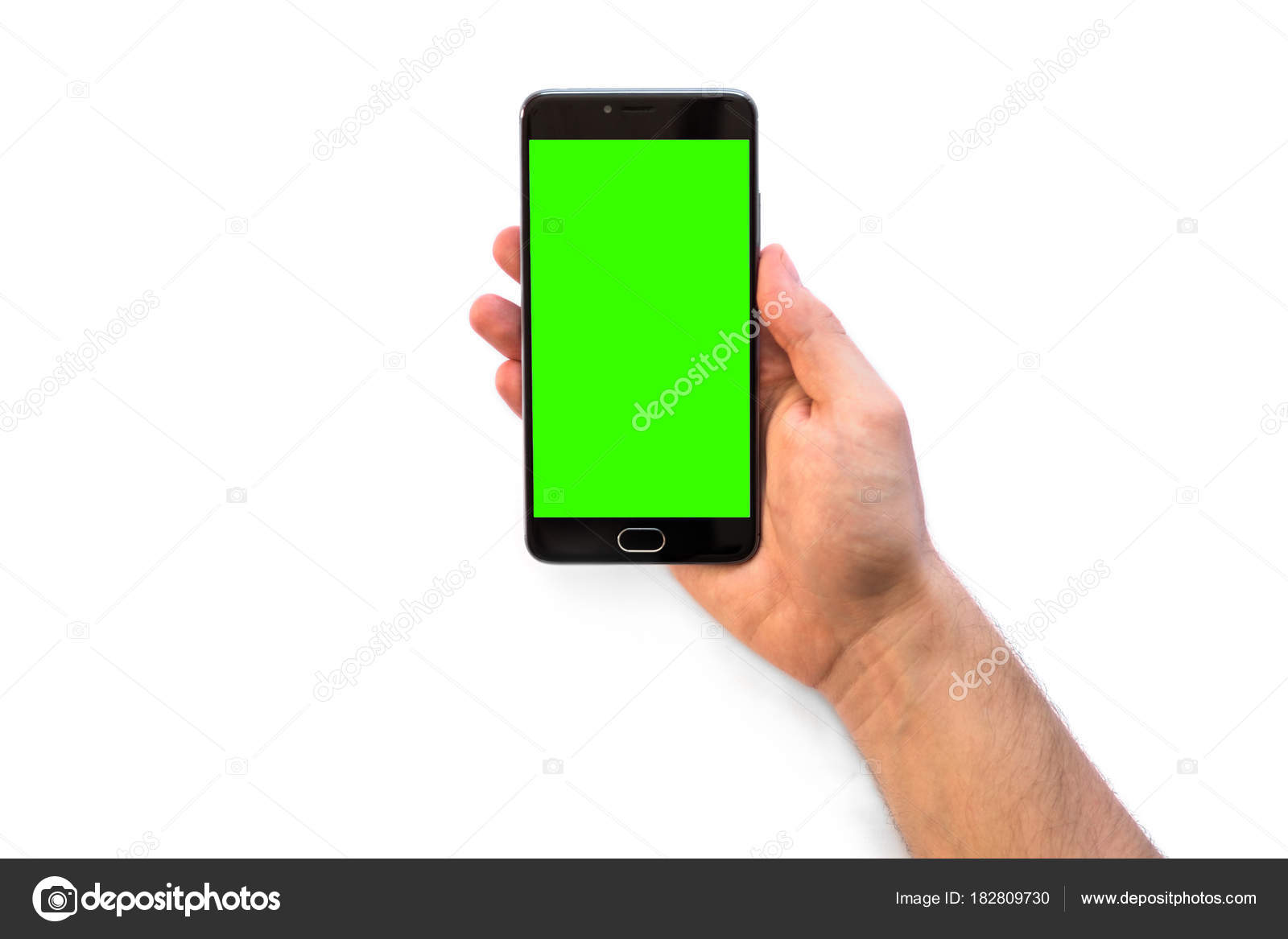 A man holding a smartphone with green screen for chroma key