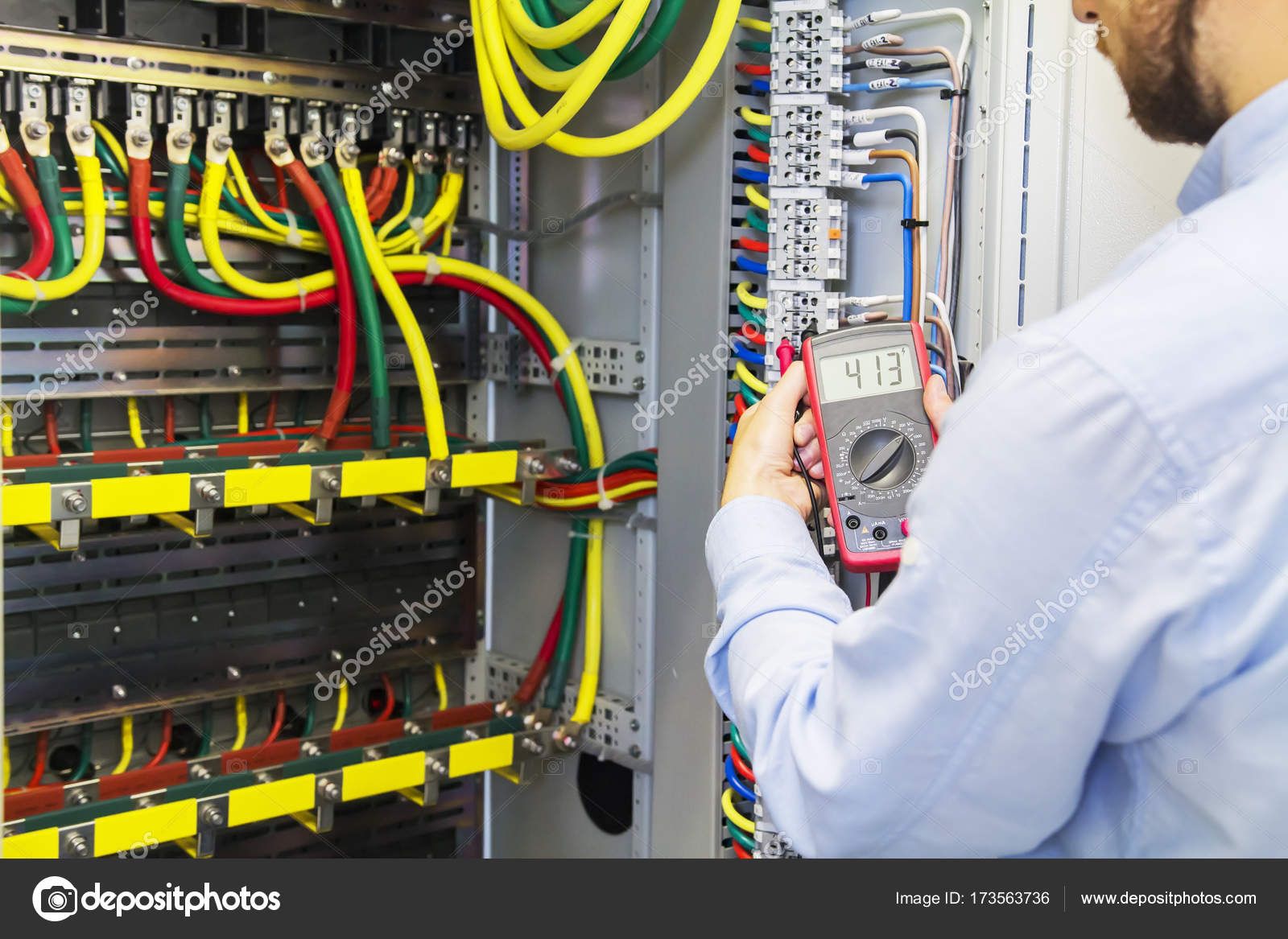 Engineer tests power high voltage three phase circuit box with multimeter.  Electric service power system. Support electrician in fuse panel — Photo by  ...