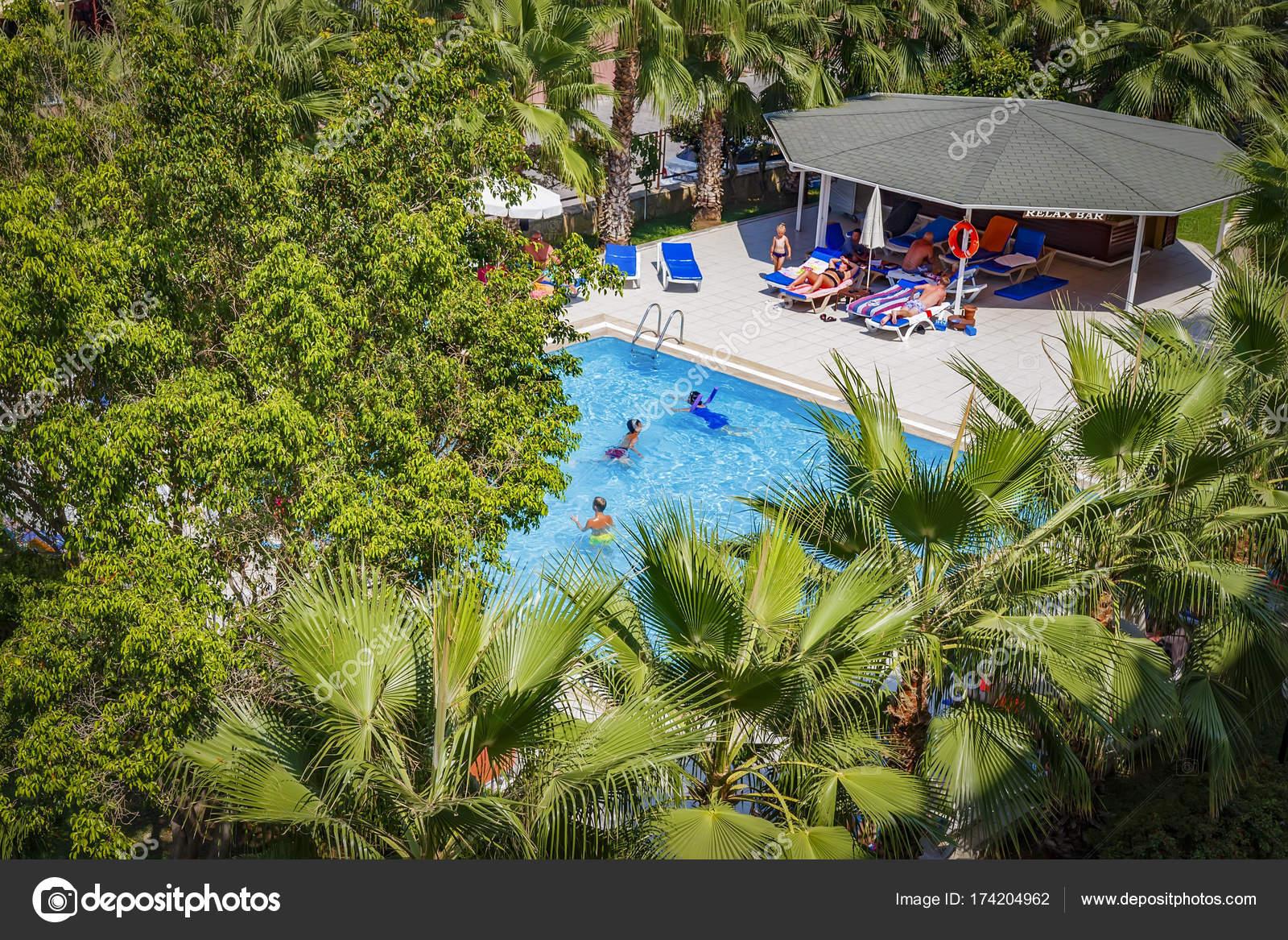 Hotel pool with people  Konakli, Turkey - August 18, 2017: Swimming pool at tropical resort ...