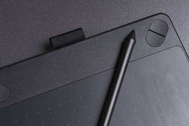 modern black graphic tablet for drawing with pen close-up.