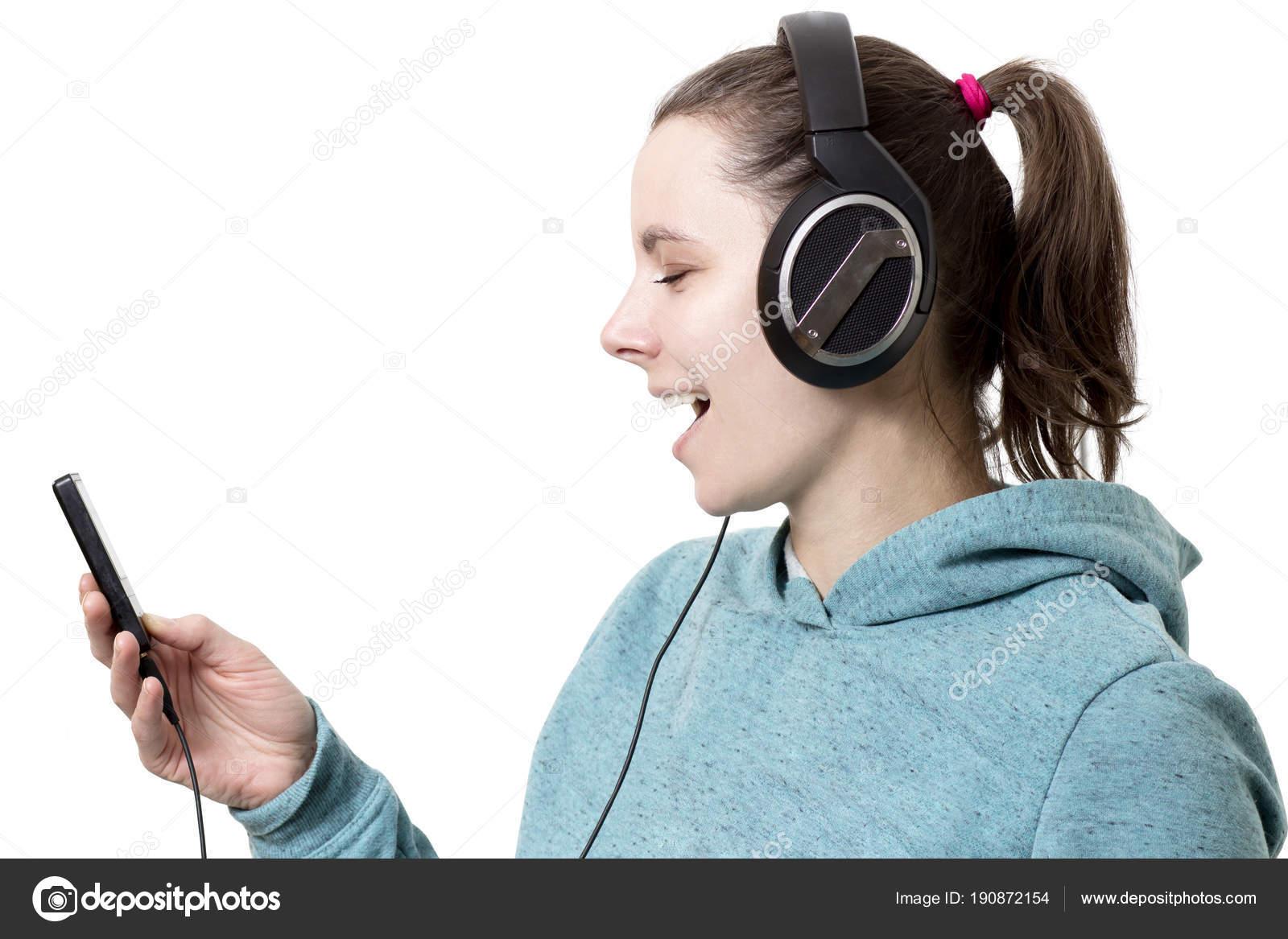 Jeune Fille Au Casque Avec Lecteur En Mains écouter De La Musique