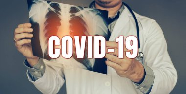 The doctor was carrying an x-ray picture and looking at the lung infection new rapidly spreading Coronavirus (Covid-19) concept. stock vector