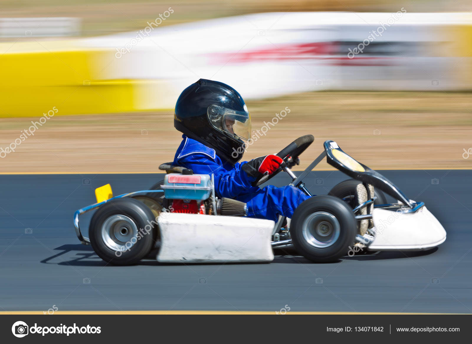 Young kid racing a go cart around a track — Stock Photo ...